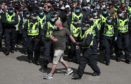 "Protesters are escorted by police from George Square in Glasgow city centre after a Glasgow Says No to Racism event aimed at ""sending a positive anti-racist message from Glasgow's George Square to the world on World Refugee Day""."