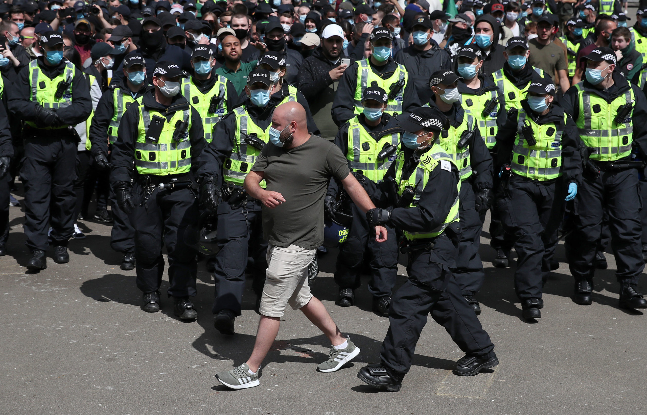 """Protesters are escorted by police from George Square in Glasgow city centre after a Glasgow Says No to Racism event aimed at """"sending a positive anti-racist message from Glasgow's George Square to the world on World Refugee Day""""."""