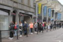 Shoppers queue outside Primark on Union Street