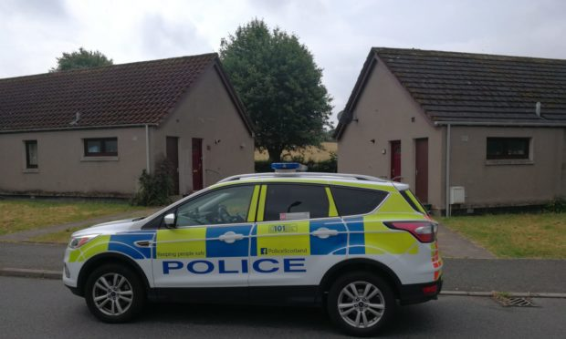 Police outside the property in Huntly.