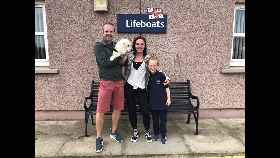 Mason with his mum Robertamay and her partner.