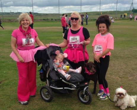 Katie Watson with her family and friend at a previous Race for Life event