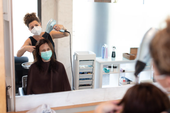 Hairdressers and barbers, holiday accommodation and childcare providers will then be able to reopen from July 15