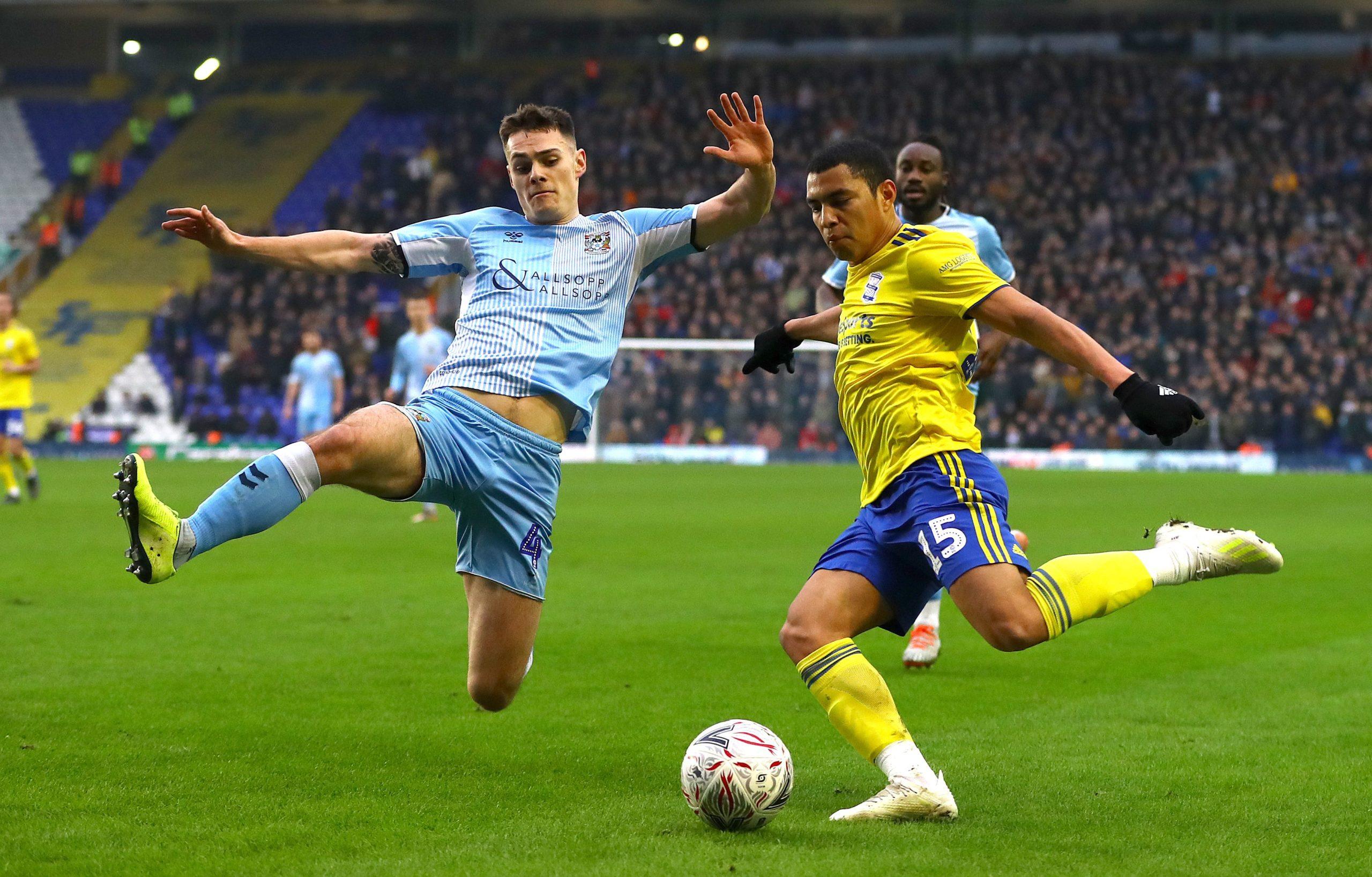 Michael Rose of Coventry City challenges Jefferson Montero of Birmingham City.