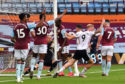 Aston Villa goalkeeper Orjan Nyland appears to carry the ball over the line as Sheffield United players appeal for a goal to be given.