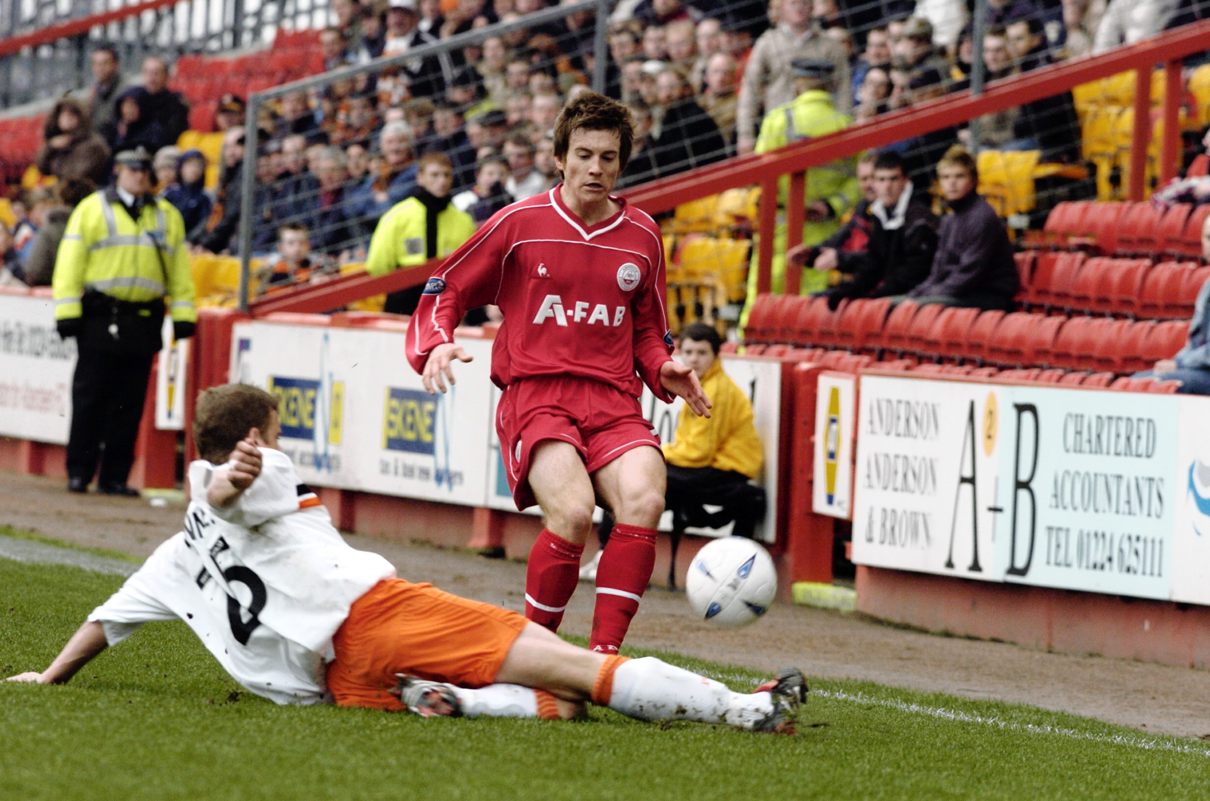 Scott Morrison in action for the Dons against Dundee United