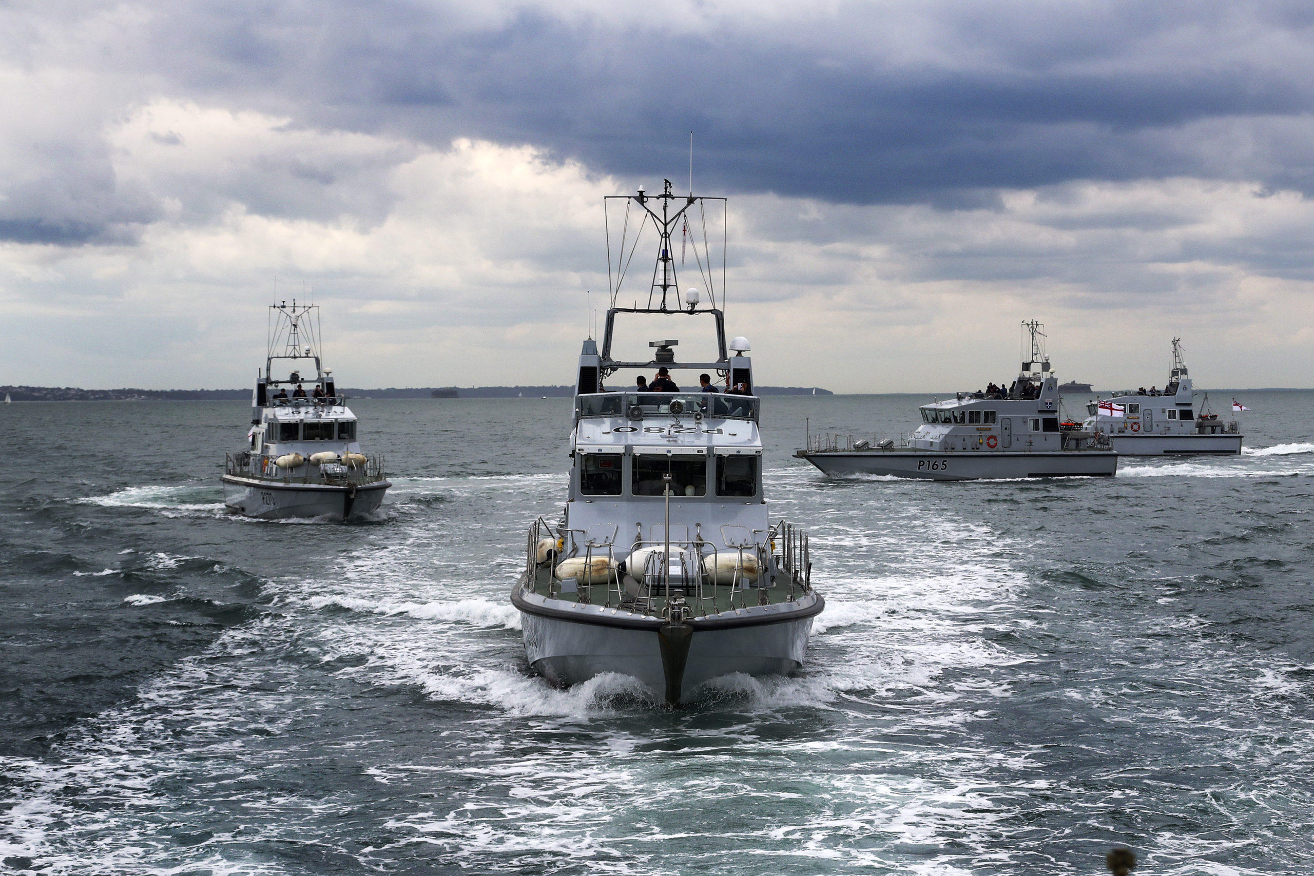 Four Archer Class P2000 Patrol Boats together at sea.