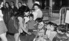Children talk to Miss World, Jennifer Hoston,  when she visited Ward 4 of Royal Aberdeen Children's hospital at Foresterhill in June 1971.