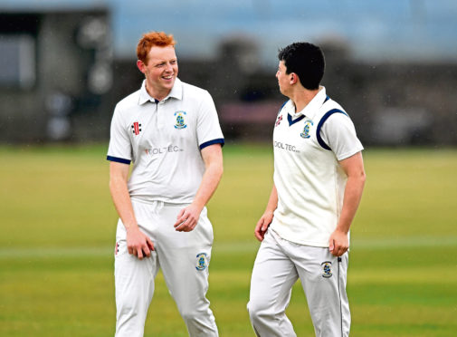 Stoneywood player Jamie King (L) celebrating his wicket with David Kidd. Picture by Scott Baxter