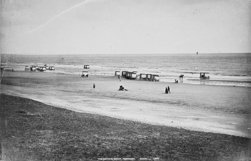 The beach has always been a popular spot, though it was not until the 20th century that the area was significantly developed and promoted. This George Washington Wilson photograph from the late 19th century shows bathers enjoying the fresh air and bracing waters in an earlier period.