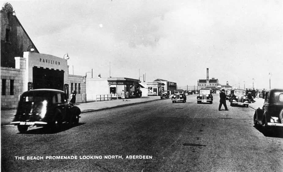 """The promenade in the 1940s. On the left of the image is the Pavilion variety theatre, most famously the home of Harry Gordon, the """"Laird of Inversnecky"""". It originally opened as a wooden structure on 6th May 1906. Following many successful summer seasons, a new, improved Pavilion opened in 1928."""