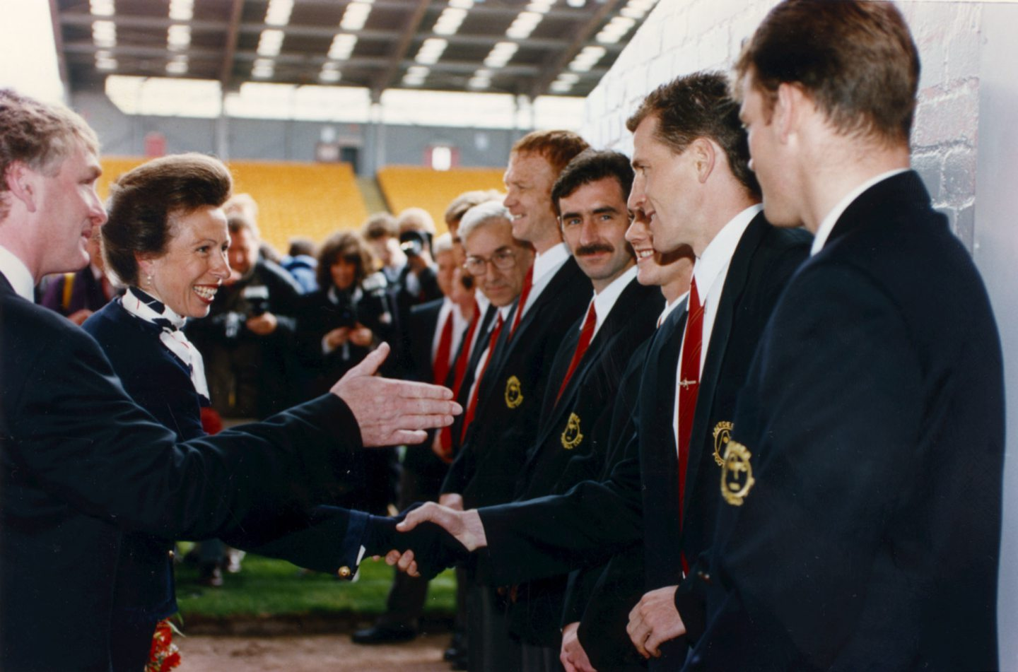 The Princess Royal was highly amused when she opened the  Richard Donald stand at Pittodrie in 1993. Here she meets Dons defender Brian Irvine as Aberdeen FC vice-chairman Ian Donald introduces her to the staff and players.