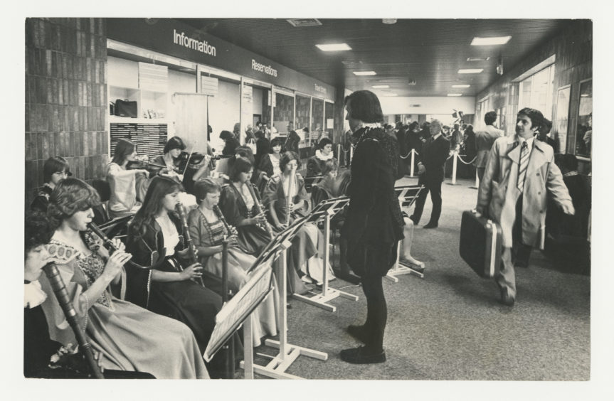 1978: Providing a musical background to the opening of British rail's new £120,000 travel centre at Aberdeen railway Station are the Kincorth Waits, a group of young musicians from Kincorth Academy, Aberdeen, who specialise in early music.  They are conducted by teacher Charles Foster.