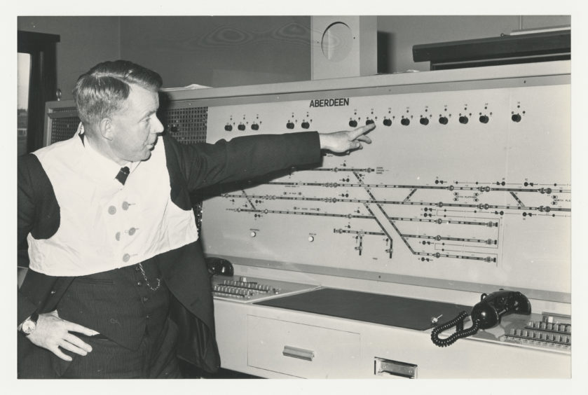 1981: Aberdeen area operations manager John Gough tests out some equipment at the new signalling centre at Aberdeen Railway Station.