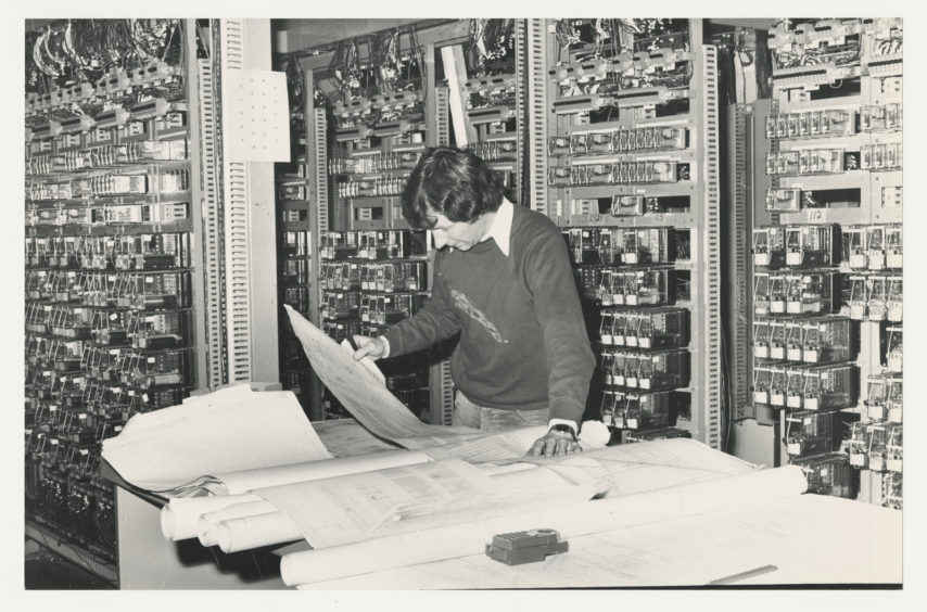 1981: Inside the new signalling centre at Aberdeen Station, Douglas Kikr works on the electrical relays for the new box