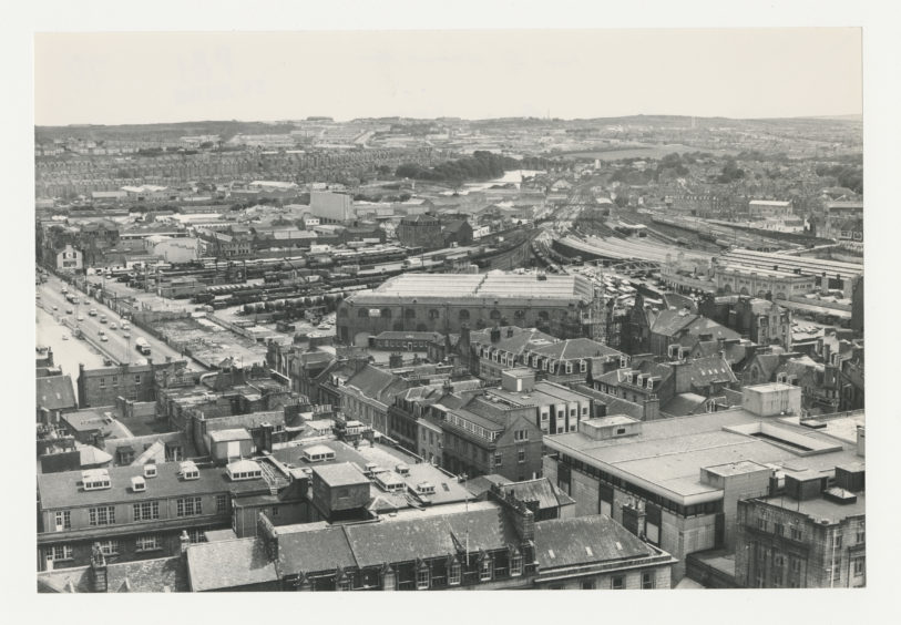 1981: Aberdeen Railway Station (centre right) as viewed from St Nicolas House municipal with South Market Street on the left of the image.