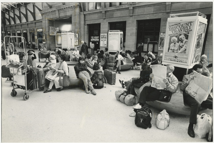 1984: Passengers whose journeys have been disrupted due to industrial action wait on Aberdeen Station concourse.
