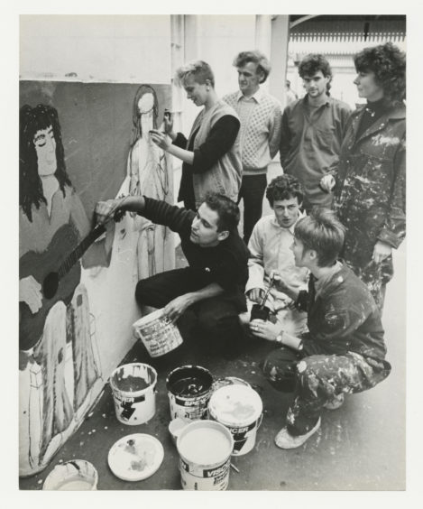 1985: A group of Aberdeen artists work on a public display at the city's railway station.  Aberdeen City District and British rail have given permission for the artists to give part of the station a colourful facelift in the form of a giant mural.  A group of artists from Aberdeen Community Arts and the Youth Information Centre hit on the idea to paint a mural in the city to mark International Youth year and the council suggested the station as a possible site.