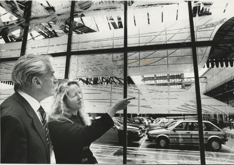 1990: The shipbuilding history of Aberdeen etched onto glass at the Aberdeen railway Station concourse.  Right: Chancellor of the University of Aberdeen Kenneth Alexander discussing the etchings with Aberdonian artist Elizabeth Ogilvie after he unveiled the screen.