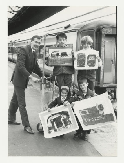1992: ScotRail's Aberdeen service manager, Steve Montgomery (left) gives a lift to the winders of the schools' painting competition held to celebrate the 125th birthday of Aberdeen Station.