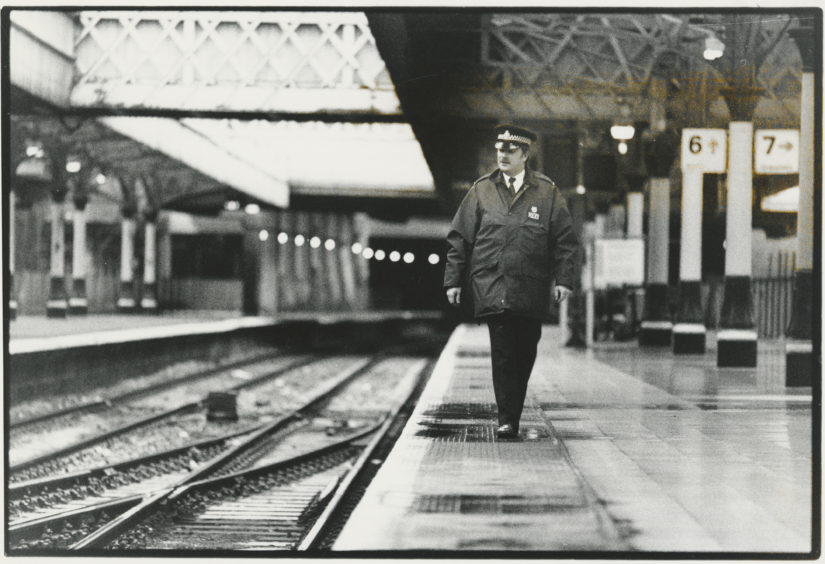 1993: A policeman patrols a deserted Aberdeen railway station platform this morning.  Trains were at a standstill today in the second rail strike in a fortnight. Early indications in the North-east seemed to show most travellers were not badly affected by the industrial action.