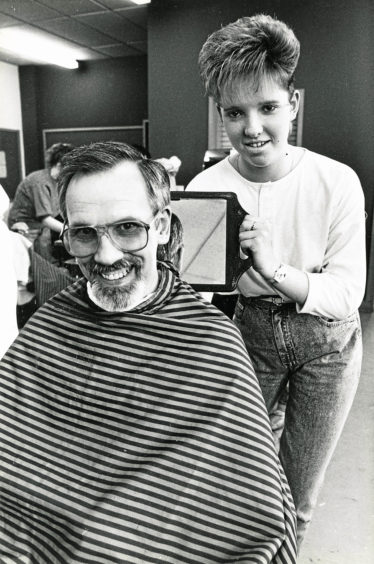 """1988: Hairdressing students at Aberdeen Technical College evening classes compete last night to create the perfect """"Modern Men's Haircut"""" Lynn Smith, Dyce, gets to grips with her father, Albert's, locks."""