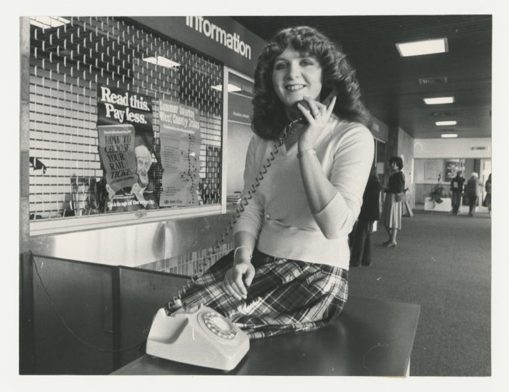 1980: Telephonist at Aberdeen railway Station, 19-year-old Susan Watt, will be one of the voices to records the new timetable message.  Susan poses with a telephone in the stations Information Centre.