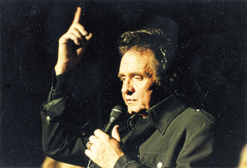 1991: Johnny Cash at the Capitol last night. Livin' up to being a living legend takes the guile and guts of a gunslinger, especially when up against Scotland's countriest of C&W fans.