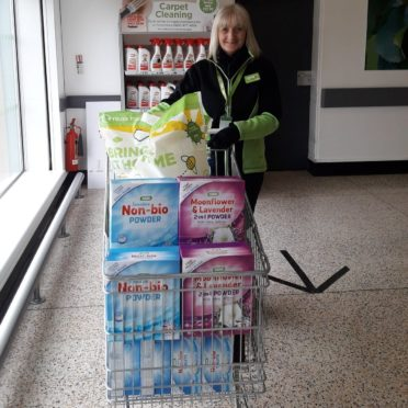 The Asda store in Dyce is asking customers to donate some purchases to their local food bank