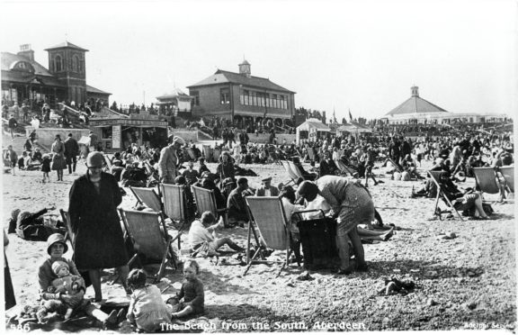 The Beach Shelter, with clock tower, can be seen in the background of this image. In addition to sheltering from the wind and rain, it was used as a landmark for reuniting youngsters separated from parents and as a meeting place before nights out at the nearby Beach Ballroom.