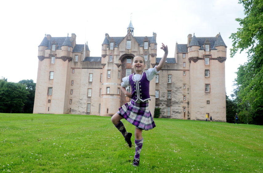 Amber Houston-McMillan, 6, takes part in a virtual dance competition around Fyvie Castle. Picture by Chris Sumner