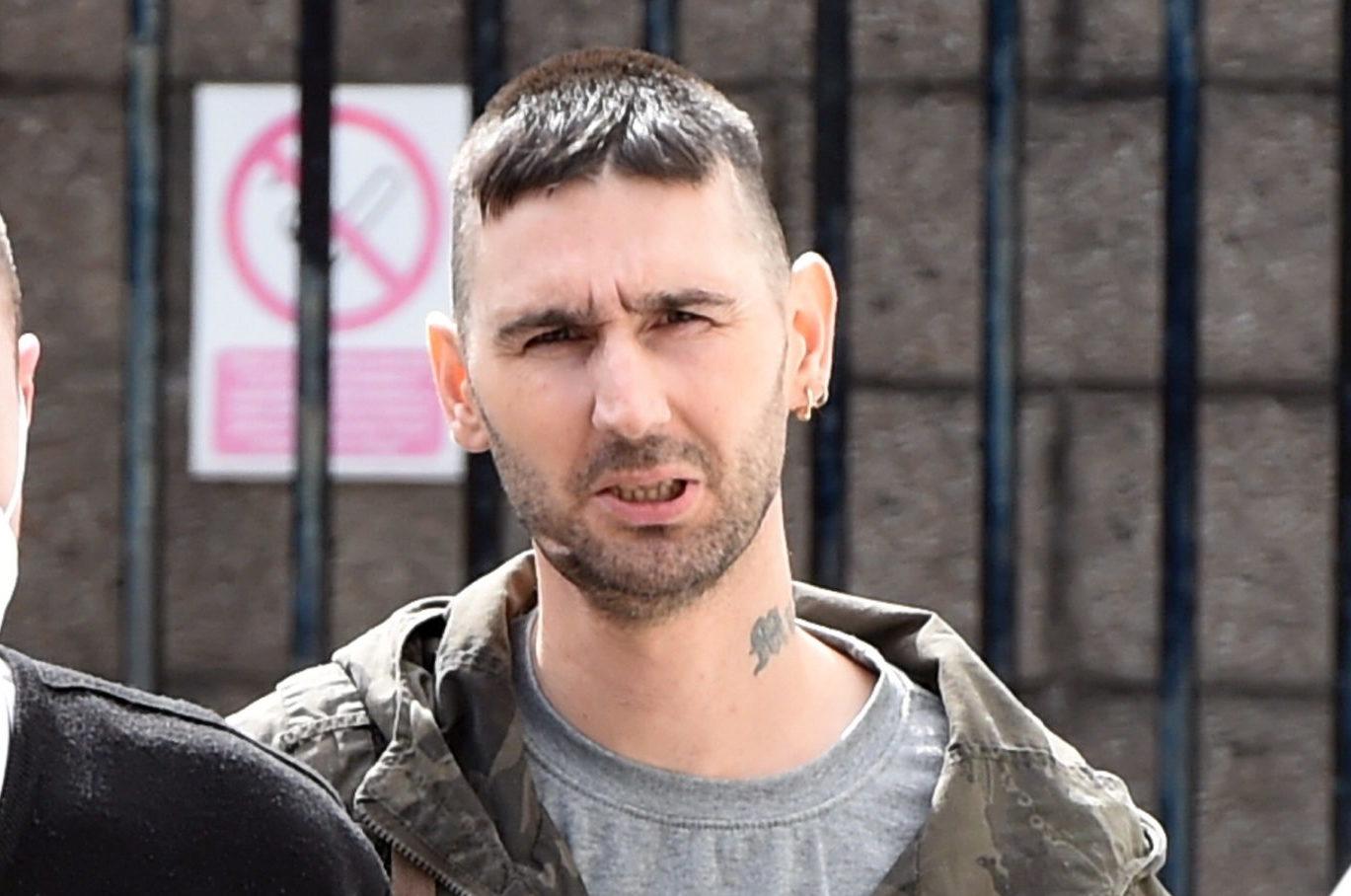 Gavin Reid leaving court.