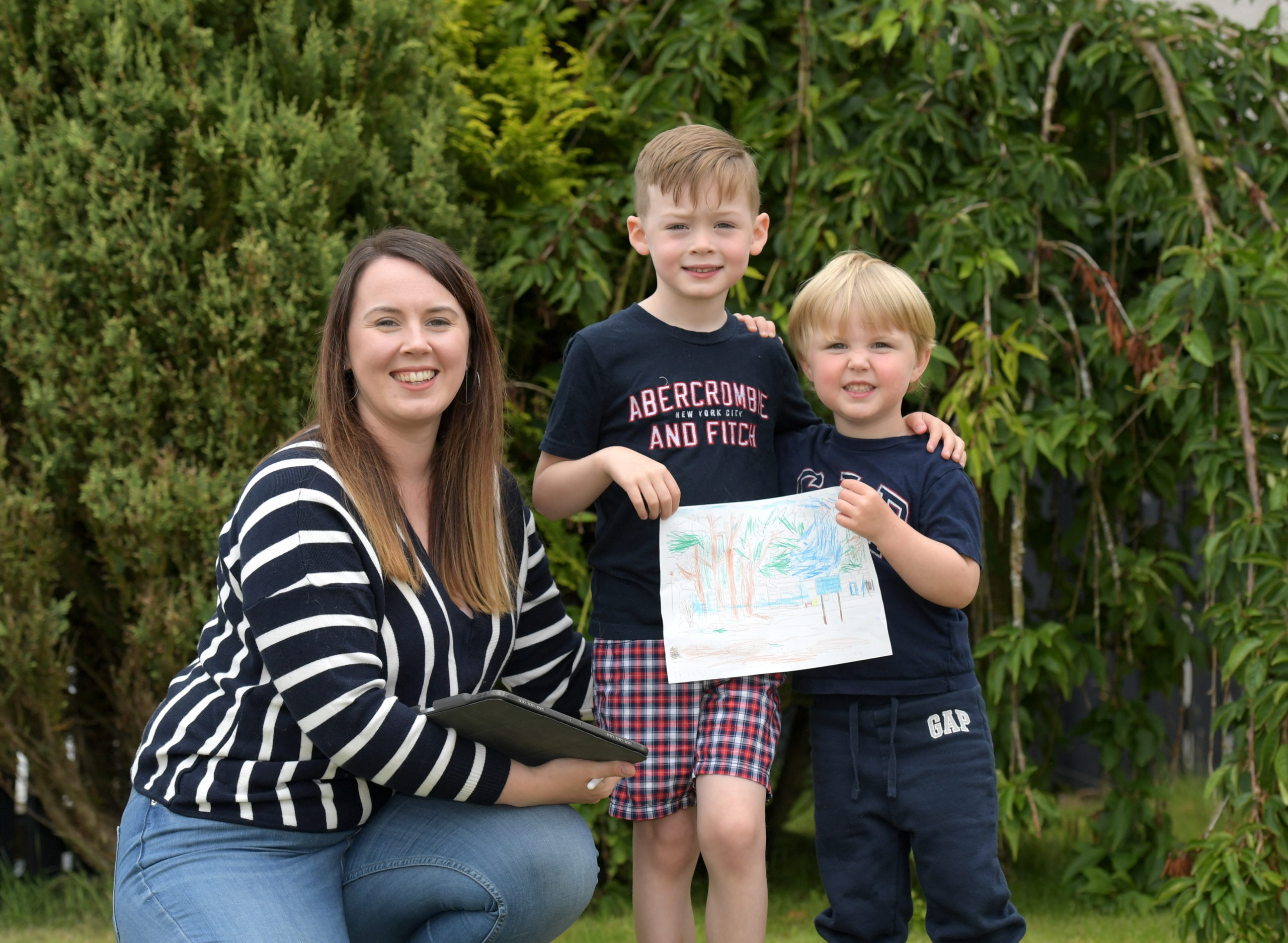 Nicola Robertson and her two sons Logan and Oliver