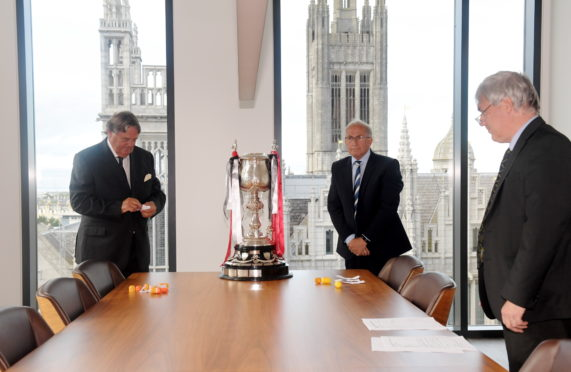 The draw for the Evening Express Aberdeenshire Cup at AJL, Marischal Square. From left, Douglas Gallacher, Alan McRae and Willie Young. Picture by Kath Flannery