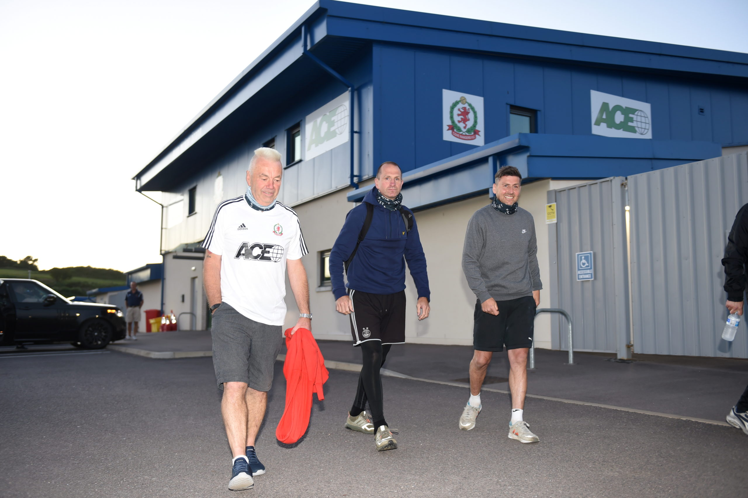 Ian Yule, Mark Perry and Roy McBain as they set off on their fundraising walk from the Balmoral Stadium to Tannadice. Picture by Paul Glendell
