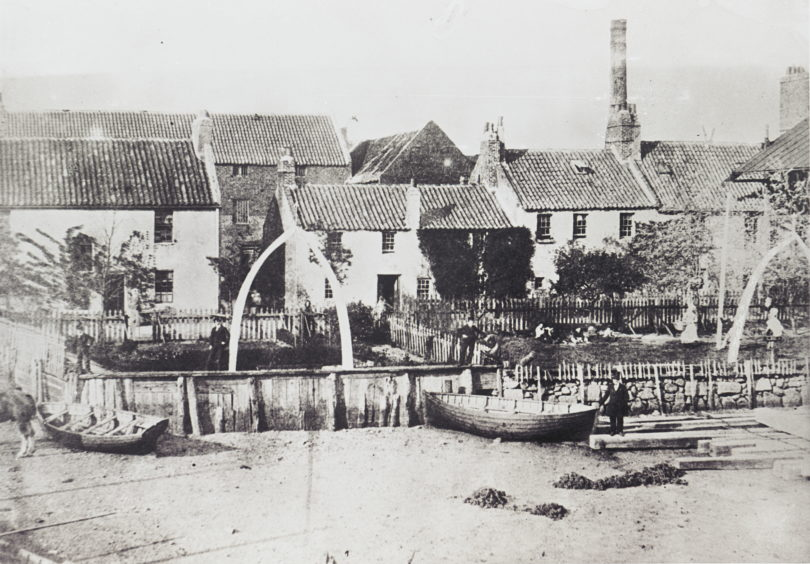 At the south end of Aberdeen Sea Beach is the historic fishing village of Fittie. This George Washington Wilson photograph, taken around 1859, shows whale bone arches in the gardens of the village. These were relics from Aberdeen's time as a significant whaling port.