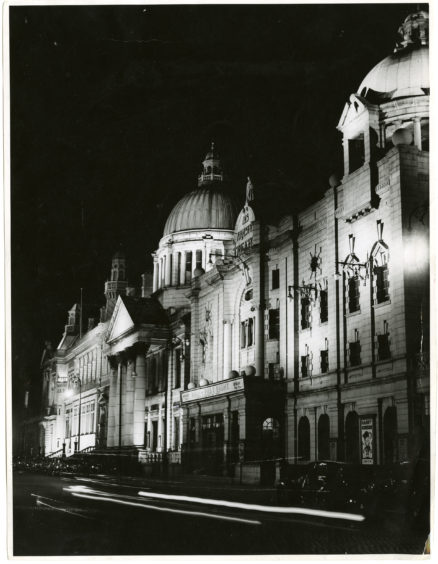 1952: A nighttime scene of HM Theatre, South Church and Aberdeen Central Library on Rosemount Viaduct, Aberdeen.