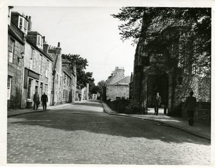 1958: The High Street, Old Aberdeen, Aberdeen.  On the right is one of the ornamented entrances to King's College.