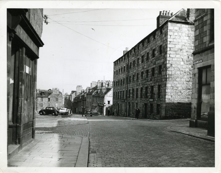1958: The old entry to Aberdeen from the north by way of the Brig o' Balgownie showing the Gallowgate with the sites of old demolished buildings on the left.