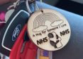 The wooden hugs raised £450 for the NHS