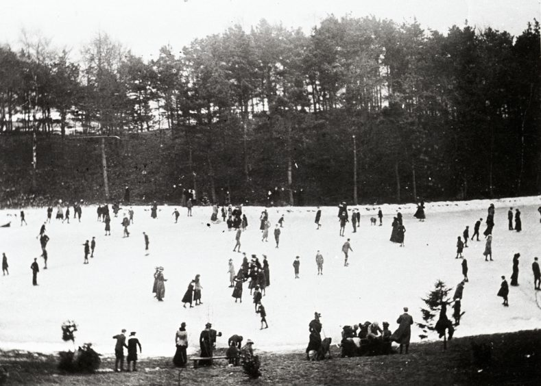 A central feature of the park was the large pond designed for curling and skating, as shown in this wintry scene from around 1902.