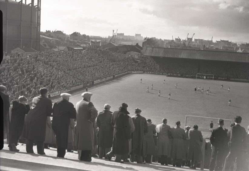 1957: Crowds watch on at a match at Pittodrie Park, Aberdee, the home of Aberdeen FC.