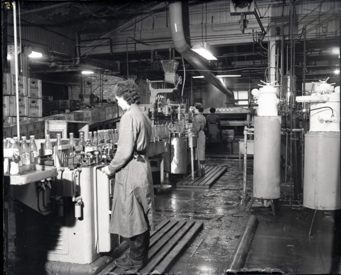 1958: Women workers inside the bottling factory of Robertson Fruit Products Ltd on Clarence Street, Aberdeen.  The company made Sun Joy and Dextora carbonated and aerated drinks.