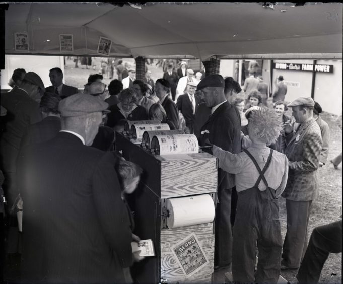 1959: Crowds surrounds the comic printing exhibit at the Thomson-Leng stand at the Royal Highland Show, Hazlehead Park, Aberdeen.