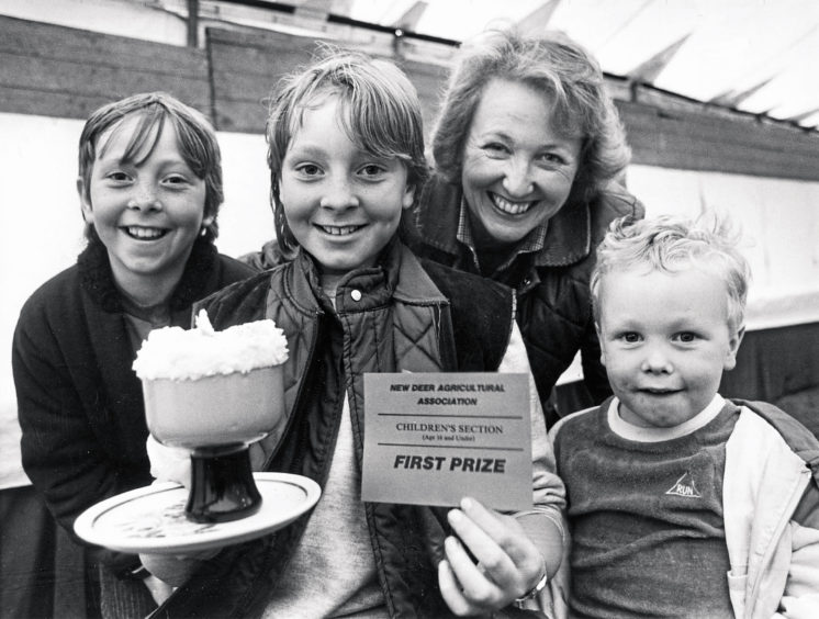 1985: No prizes for telling how well Jane Fowlie,12, did in the under 16 years individual dessert competition at New Deer Show yesterday. Congratulating Jane, Loanhead, New Deer, on her tasty treat are mum, Pamela, sister Suzanne, 10, and four-year-old brother John, who seems to be licking his lips ready to give his personal verdict on the winning entry.