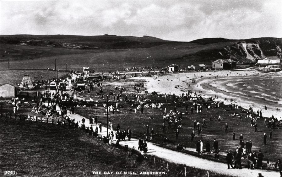 On the other side of the lighthouse, the Bay of Nigg was a popular coastal spot for those living south of the River Dee. This 1930s postcard shows the area with crowds of day-trippers. The bay is currently being developed as part of Aberdeen's new South Harbour project.