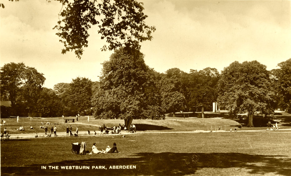 This image shows the park in the early to mid-20th century. Note the unfenced tennis courts north of the burn. In contrast to the ornamental style of Victoria Park, Westburn was intended to provide ample space for all forms of recreation, particularly for young people.