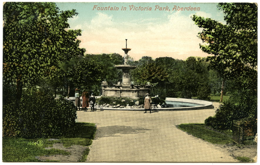 Early 20th century colour postcard showing the fountain at the centre of Victoria Park. The fountain was designed by J.B. Pirie and built of 14 different types of granite. It was presented to the park by the master masons of Aberdeen and completed in 1881.