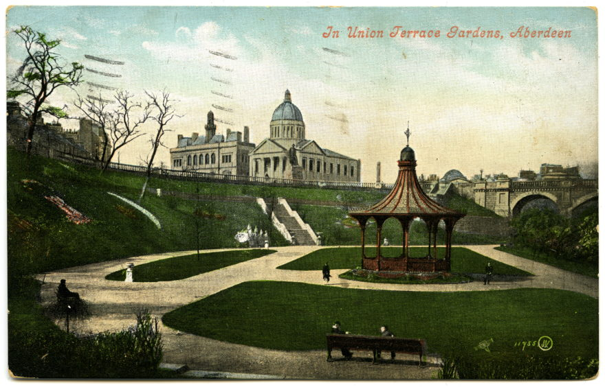 A colour postcard showing Union Terrace Gardens in the late 19th century. Note the absence of His Majesty's Theatre above. The image shows the original lay-out of the park and its old bandstand. The latter was removed in the early 1930s.