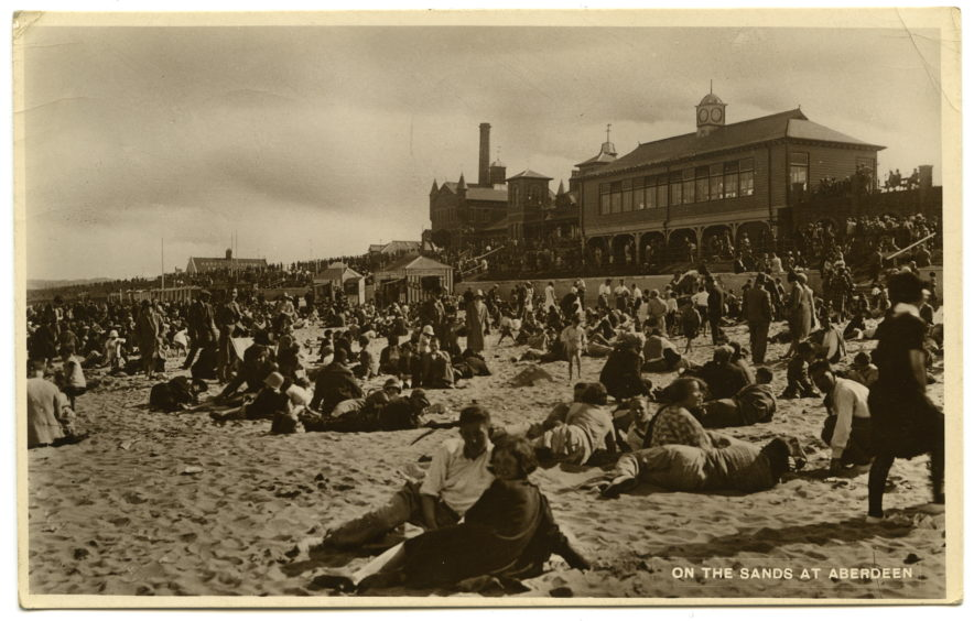 Aberdeen's beach once played a major role in establishing the city as one of Britain's leading holiday resorts. This 1930s postcard shows crowded sands with stalls selling ices and those for changing in the background. The Beach Shelter, Bathing Station and Pavilion Theatre can be seen on the promenade.
